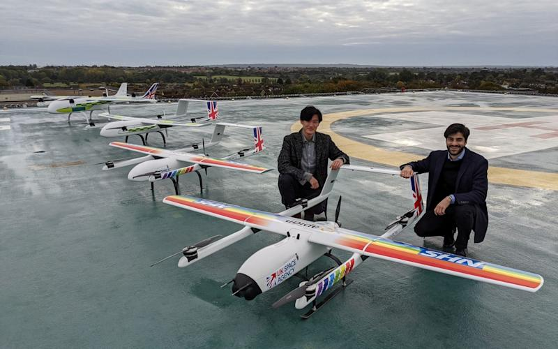 Hammad Jeilani and Christopher Law with their drones - PA/Annalisa Russell-Smith