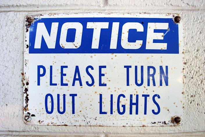 """<span class=""""caption"""">Dark is good.</span> <span class=""""attribution""""><a class=""""link rapid-noclick-resp"""" href=""""http://www.shutterstock.com/pic-631987/stock-photo-old-rusty-sign-that-reads-notice-please-turn-out-lights.html?src=oCxeJa52T_KWaPR5Agi5wQ-4-43"""" rel=""""nofollow noopener"""" target=""""_blank"""" data-ylk=""""slk:Sign image via www.shutterstock.com."""">Sign image via www.shutterstock.com.</a></span>"""