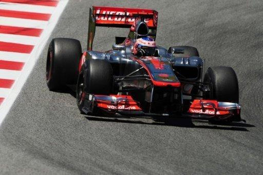 Jenson Button whizzes around the Circuit de Catalunya during the second practice session