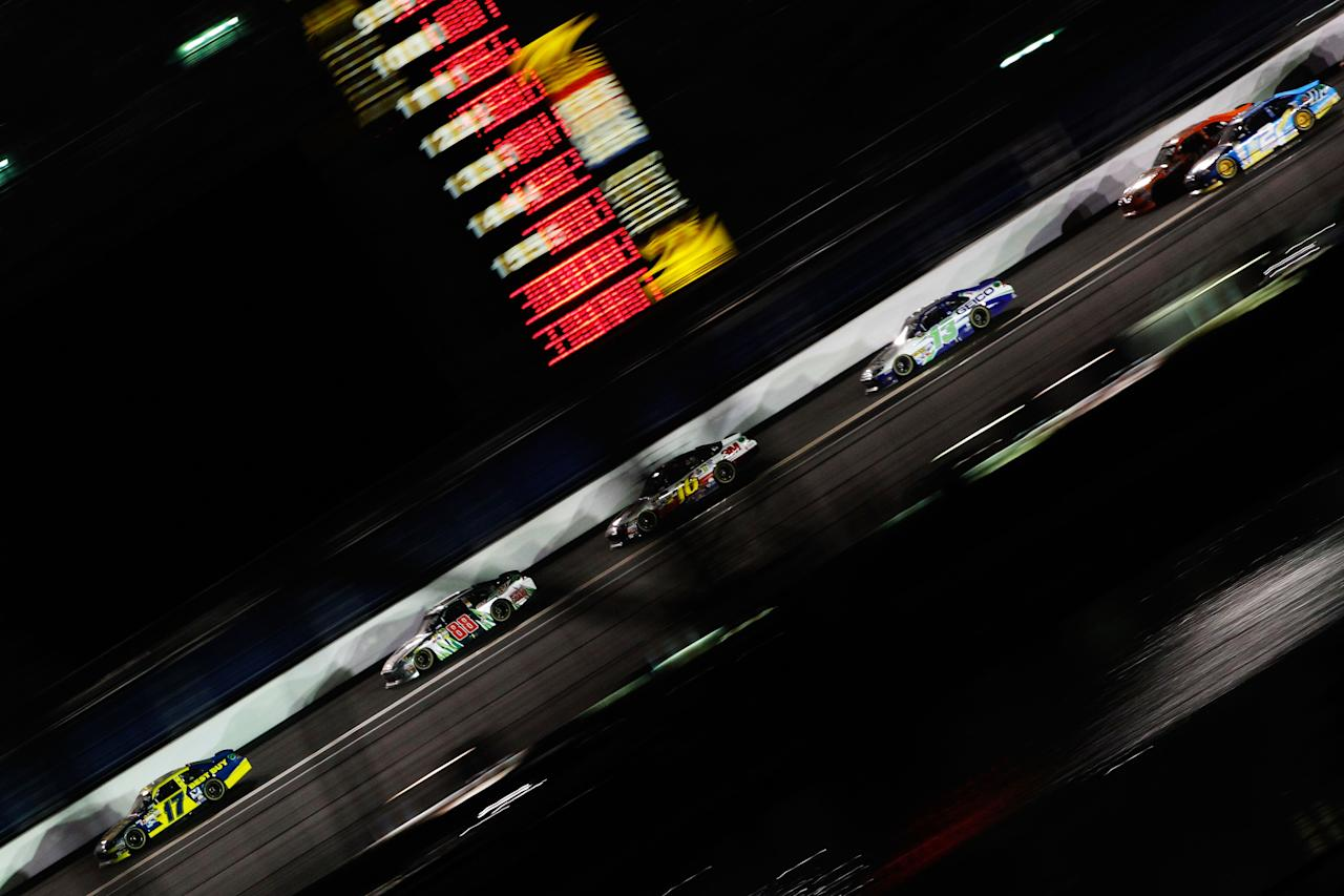 DAYTONA BEACH, FL - FEBRUARY 27:  Matt Kenseth, driver of the #17 Best Buy Ford, leads Dale Earnhardt Jr., driver of the #88 Diet Mountain Dew/National Guard Chevrolet, Greg Biffle, driver of the #16 3M Ford, Casey Mears, driver of the #13 GEICO Ford, and Brad Keselowski, driver of the #2 Miller Lite Dodge, down the backstretch during the NASCAR Sprint Cup Series Daytona 500 at Daytona International Speedway on February 27, 2012 in Daytona Beach, Florida.  (Photo by Tom Pennington/Getty Images for NASCAR)