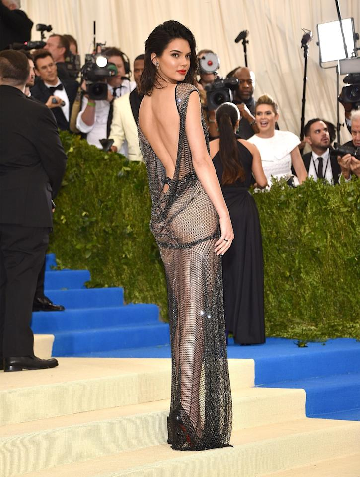 <p>Kendall copied Rose McGowan's famed VMAs look by baring her backside in a La Perla gown.<br /><i>[Photo: Getty]</i> </p>