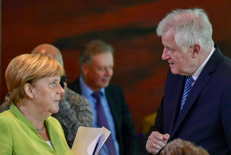"A truce within German Chancellor Angela Merkel's conservative camp has shattered with her hardline interior minister Horst Seehofer defending protests marred by neo-Nazi violence and blasting migration as ""the mother of all political problems"""