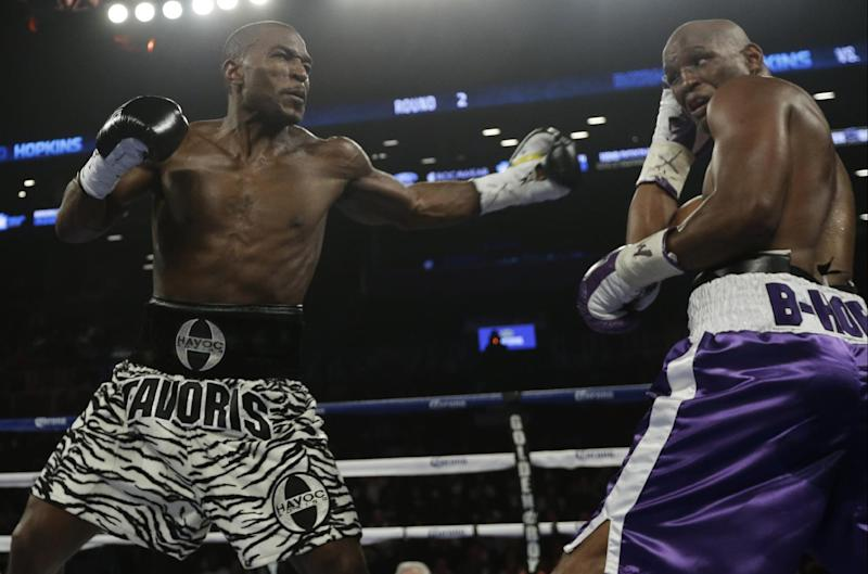 Bernard Hopkins, right, avoids a punch by Tavoris Cloud, left, during the second round of an IBF Light Heavyweight championship boxing match at the Barclays Center Saturday, March 9, 2013, in New York. Hopkinds won by unanimous decision.(AP Photo/Frank Franklin II)