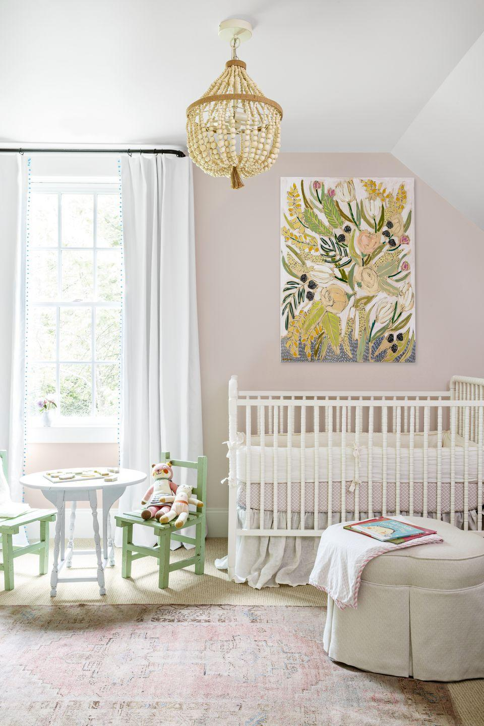 """<p>Tickled pin with the family's new addition, Tennessee homeowner Mandy Reeves swathed her daughter's nursery in a lovely shade of blush. The color is subtle and works well with soft whites and other pastel colors. </p><p><strong>Get the Look: </strong><br>Wall Paint Color: <a href=""""https://www.sherwin-williams.com/homeowners/color/find-and-explore-colors/paint-colors-by-family/SW6322-intimate-white"""" rel=""""nofollow noopener"""" target=""""_blank"""" data-ylk=""""slk:Intimate White by Sherwin-Williams"""" class=""""link rapid-noclick-resp"""">Intimate White by Sherwin-Williams</a></p>"""