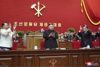 """In this photo provided by the North Korean government, North Korean leader Kim Jong Un, center, claps his hands at the ruling party congress in Pyongyang, North Korean, Sunday, Jan. 10, 2021. Kim was given a new title, """"general secretary"""" of the ruling Workers' Party, formerly held by his late father and grandfather, state media reported Monday, Jan. 11, in what appears to a symbolic move aimed at bolstering his authority amid growing economic challenges. Independent journalists were not given access to cover the event depicted in this image distributed by the North Korean government. The content of this image is as provided and cannot be independently verified. Korean language watermark on image as provided by source reads: """"KCNA"""" which is the abbreviation for Korean Central News Agency. (Korean Central News Agency/Korea News Service via AP)"""