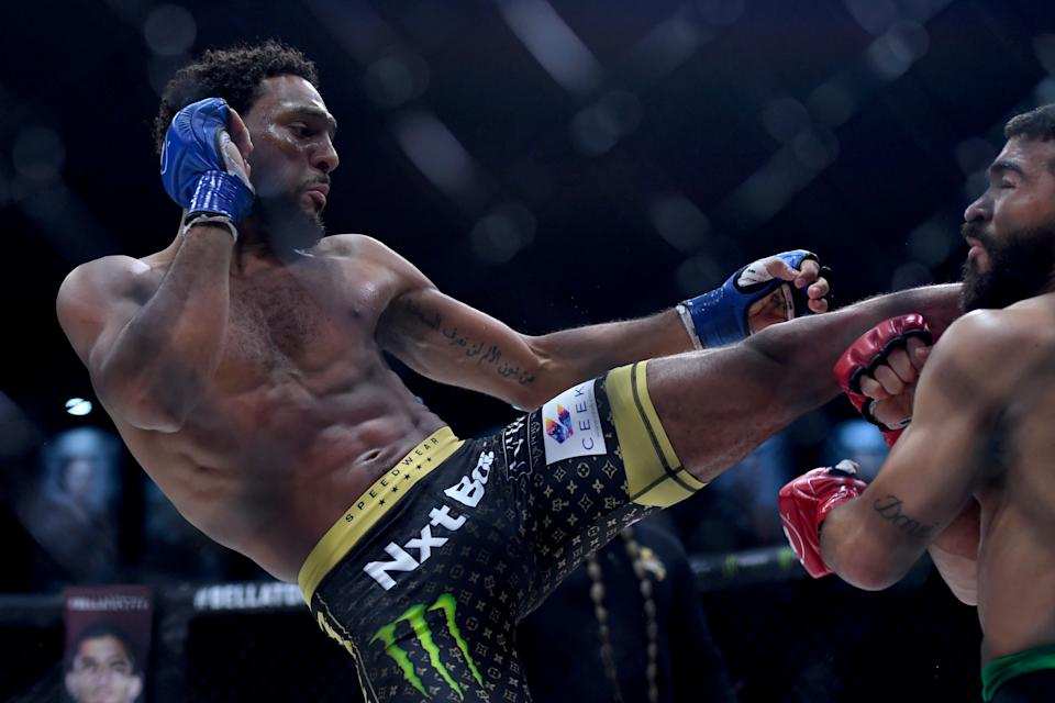 Inglewood, CA - July 31: AJ McKee blue gloves, kicks Patricio PitbullFreire, red gloves, during Bellator 263: Pitbull vs. McKee at the Forum in Inglewood, CA., Saturday, July 31, 2021. McKee defeated Freire to win the 145-pound World Grand Prix tournament million dollar prize and the championship belt. (Photo by Hans Gutknecht/MediaNews Group/Los Angeles Daily News via Getty Images)