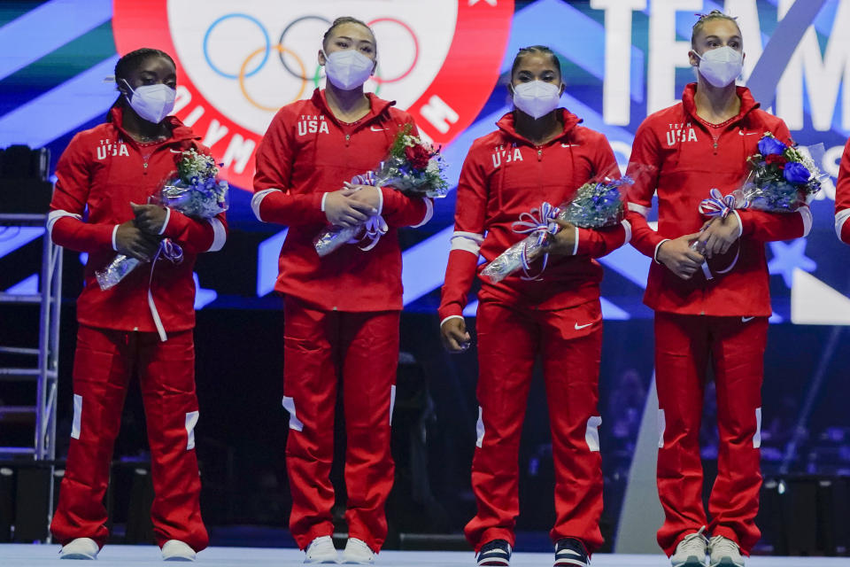 Members of the U.S. Women's Olympic Gymnastic Team, Simone Biles, Suni Lee, Jordan Chiles and Grace McCallum (L-R) are announced after the U.S. Olympic Gymnastics Trials Sunday, June 27, 2021, in St. Louis. (AP Photo/Jeff Roberson)