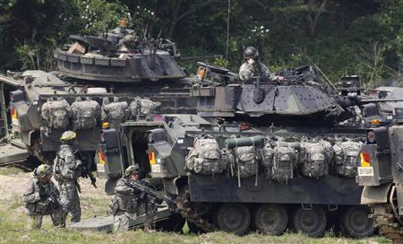 U.S. Army soldiers and its M2A2 Bradley fighting vehicles take part in the U.S.-South Korea joint military exercise against possible attacks by North Korea, at a shooting range near the demilitarized zone separating the two Koreas in Paju