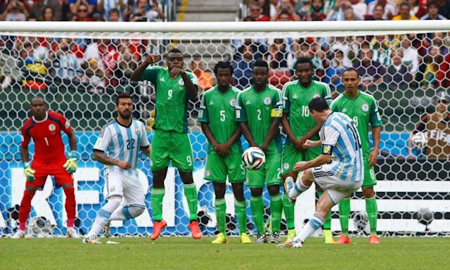"""<span class=""""element-image__caption"""">Lionel Messi scores for Argentina against Nigeria at the 2014 World Cup, with Mikel John Obi second from right in the wall.</span> <span class=""""element-image__credit"""">Photograph: Stefano Rellandini/Reuters</span>"""