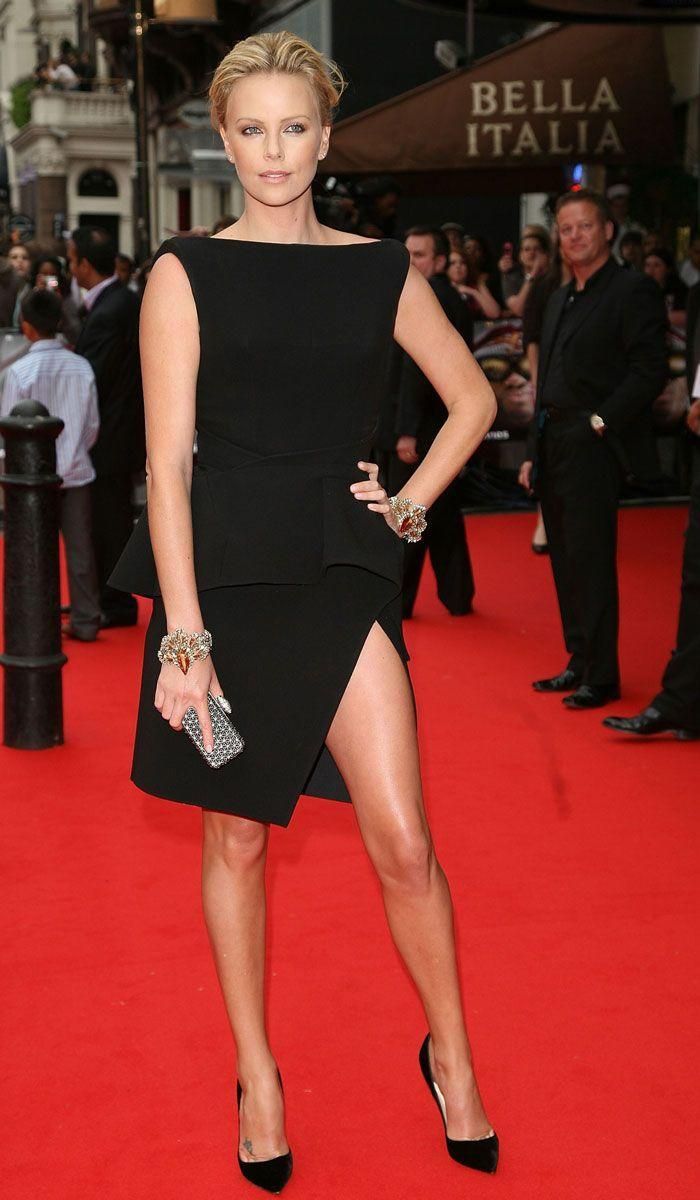 <p>At the <em>Hancock </em>premiere in London, Charlize Theron rocked the red carpet in a peplum black dress with a sky-high slit. </p>
