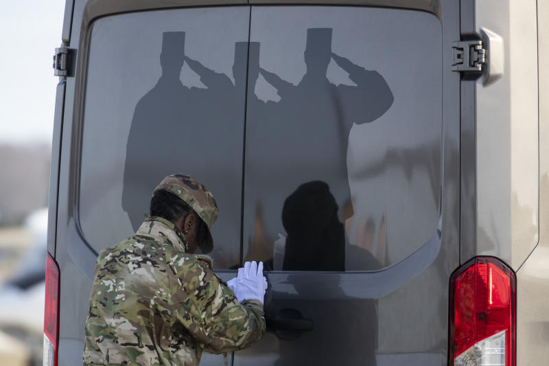 U.S. Air Force Tech. Sgt. Shaquita Darby closes the door of a vehicle containing a transfer case of the remains of U.S. Army Sgt. 1st Class Michael Goble, Wednesday, Dec. 25, 2019, at Dover Air Force Base, Del. According to the Department of Defense, Goble, of Washington Township, N.J., assigned to the 7th Special Forces Group, died while supporting Operation Freedom's Sentinel. (AP Photo/Alex Brandon)
