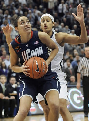Connecticut's Bria Hartley, left, is guarded by Notre Dame's Skylar Diggins during the the first half of an NCAA college basketball game in the final of the Big East women's tournament in Hartford, Conn., Tuesday, March 6, 2012. (AP Photo/Jessica Hill)