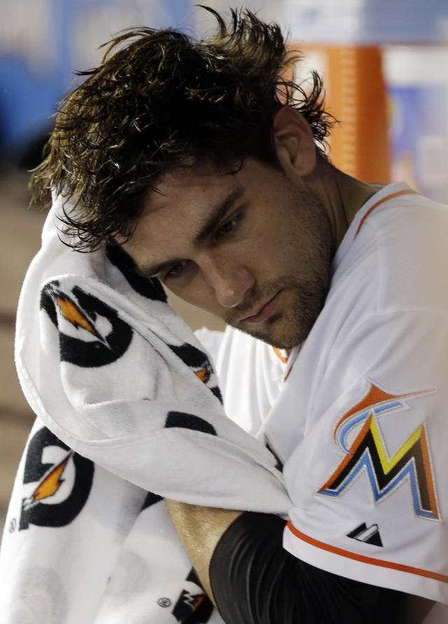 Miami Marlins starting pitcher Nate Eovaldi wipes his face after pitching during the first inning of an interleague baseball game against the Seattle Mariners, Friday, April 18, 2014, in Miami. (AP Photo/Lynne Sladky)