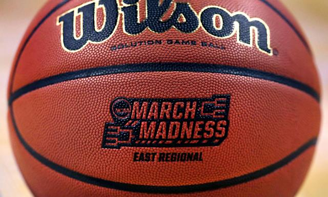 """The """"March Madness"""" logo adorns a ball resting on the court during practice at the NCAA men's college basketball tournament. (AP Photo/Charles Krupa)"""