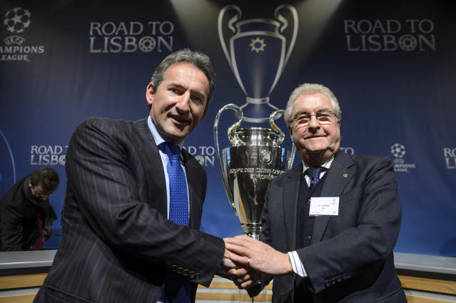 Manchester City football director Txiki Begiristain, left, shakes hands with former FC Barcelona vice-president and grandfather to Gerard Pique, Amador Bernabeu, right, after the draw of the round of 16 games of UEFA Champions League 2013/14 at the UEFA Headquarters in Nyon, Switzerland, Monday, Dec.16, 2013. (AP Photo/Keystone,Laurent Gillieron)