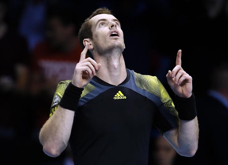 Andy Murray of Britain celebrates at match point after beating Tomas Berdych of the Czech Republic during their singles tennis match at the ATP World Tour Finals in London Monday, Nov. 5, 2012. (AP Photo/Kirsty Wigglesworth)