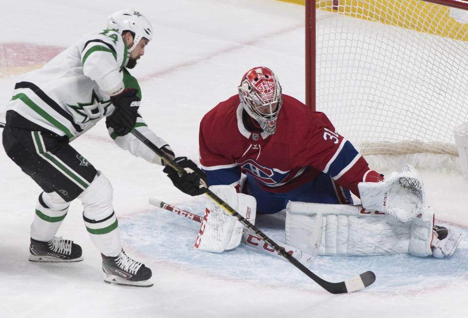 Dallas Stars' Jamie Benn moves in on Montreal Canadiens goaltender Carey Price during the first period of an NHL hockey game Saturday, Feb. 15, 2020, in Montreal. (Graham Hughes/The Canadian Press via AP)