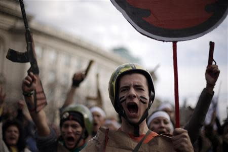 Protesting students wearing fake military uniforms shout anti-government slogans during a demonstration in front of Sofia University