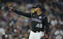 Colorado Rockies starting pitcher German Marquez reacts after Milwaukee Brewers' Avisail Garcia hit into a double play to end the top of the sixth inning of a baseball game Thursday, June 17, 2021, in Denver. (AP Photo/David Zalubowski)