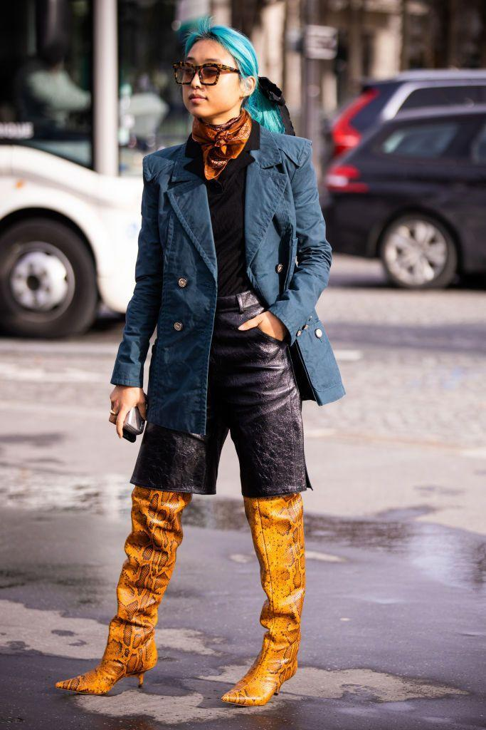 <p>Bright snakeskin-printed boots, paired with black knee-length shorts and a navy blazer are an inventive and stylish way to wear these shoes. Add a neck scarf and sunnies to finish it off. </p>