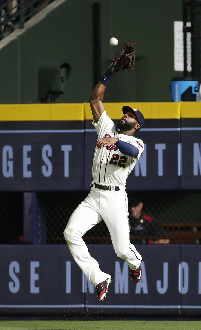 Atlanta Braves right fielder Jason Heyward makes a catch to retire Washington Nationals' Wilson Ramos in the ninth inning of a baseball game early Sunday, Aug. 10, 2014, in Atlanta. (AP Photo/John Bazemore)