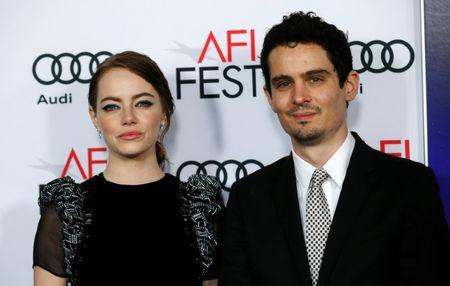 "Director of the movie Chazelle and cast member Stone pose at the premiere of ""La La Land"" during AFI FEST in Hollywood"