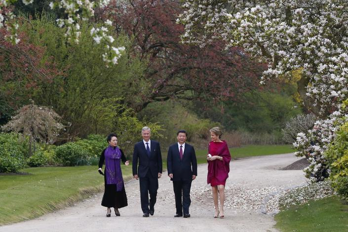 FILE - In this Sunday, March 30, 2014 file photo, from right, Belgium's Queen Mathilde, China's President Xi Jinping, Belgium's King Philippe and Chinese First Lady Peng Liyuan walk in the Royal Gardens of Laeken, Belgium. In a pandemic time rife with restrictions, demands to respect social distancing have become quasi impossible to respect in public parks. One family in town though, has a lush garden all its own and ever more voices are being raised that the Royal Family of King Philippe should loosen up and open up at least part of their Park of Laeken to the public. (AP Photo/Yves Herman, Pool, File)