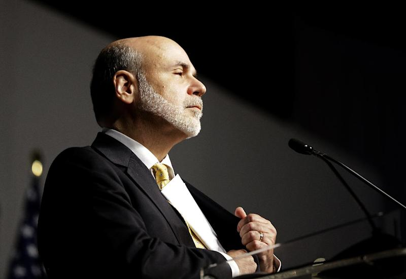 Federal Reserve Chairman Ben Bernanke puts his speech away into his jacket pocket after offering the keynote speech at the Operation HOPE Global Financial Dignity Summit Thursday, Nov. 15, 2012, in Atlanta. Bernanke said Thursday that banks' overly tight lending standards may be holding back the U.S. economy by preventing creditworthy borrowers from buying homes. (AP Photo/David Goldman)
