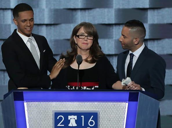 """<div class=""""inline-image__caption""""><p>Christine Leinonen, mother of Christopher 'Dru' Leinonen, is comforted by Brandon Wolf (L) and Jose Arriagada (R), survivors of the attack at the Pulse nightclub in Orlando, as they stand on stage during the third day of the Democratic National Convention at the Wells Fargo Center, July 27, 2016 in Philadelphia, Pennsylvania.</p></div> <div class=""""inline-image__credit"""">Alex Wong/Getty Images</div>"""