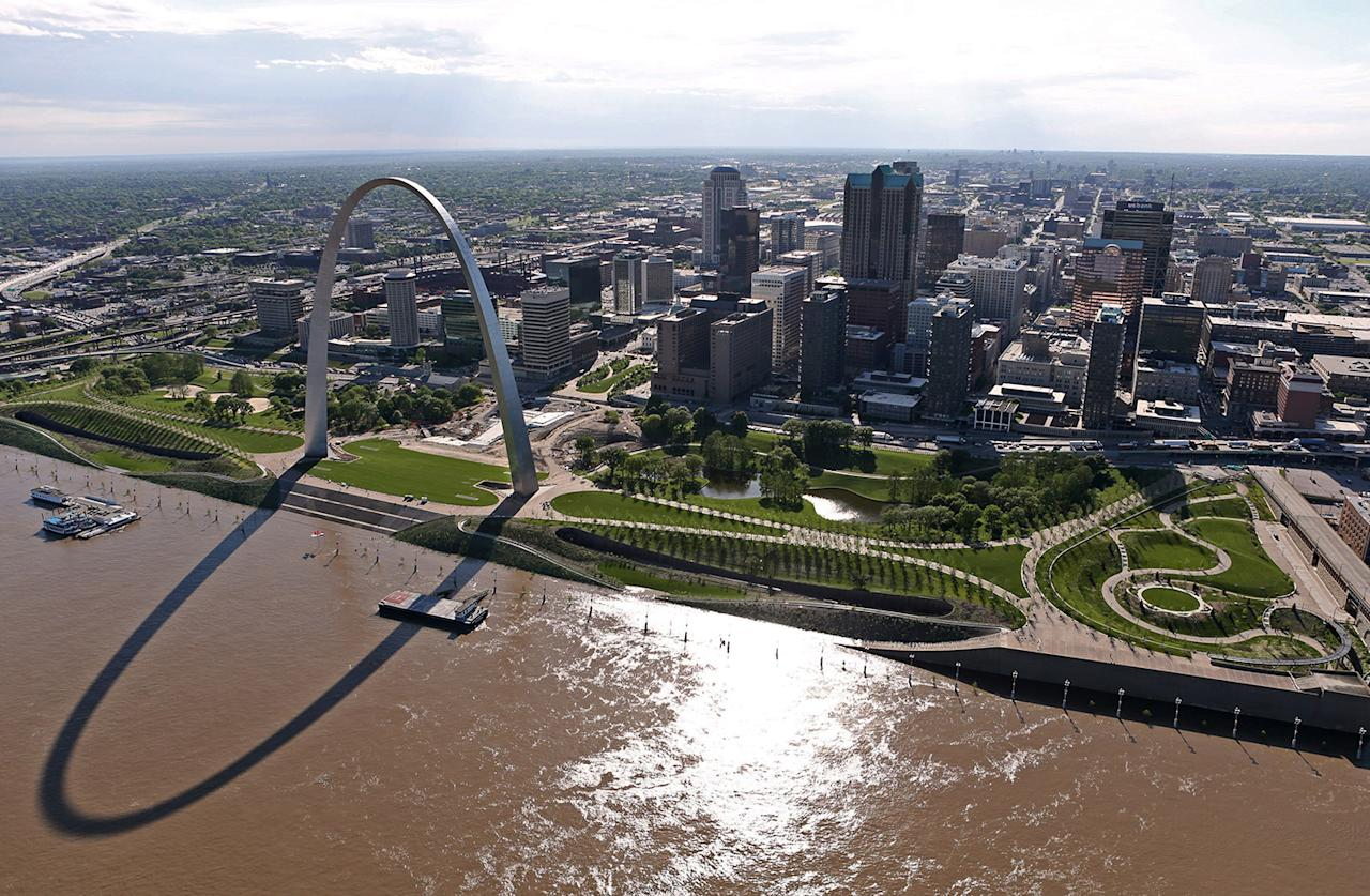 <p>The swollen Mississippi River flows past the redesigned Arch grounds in St. Louis., May 2, 2017. River levels are cresting in several Missouri communities as floodwaters slowly drain from the state, although forecasts for more rain could cause another round of damaging high water. (David Carson/St. Louis Post-Dispatch via AP) </p>