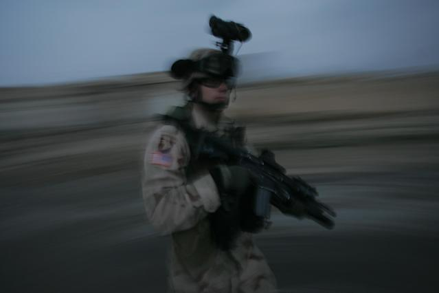 <p>A U.S. soldier with the 1st Brigade, 25th Infantry Division walks the streets during a dusk patrol on January 18, 2005, in Tal Afar, Iraq. During the patrol the soldiers fired on a car when it failed to stop and came toward soldiers, despite warning shots beign fired. The car held an Iraqi family of which the mother and father were killed. According to the U.S. Army, six children in the in the car survived, one with a non-life threatening flesh wound. U.S. military said they are is investigating the incident. (Photo by Chris Hondros/Getty Images) </p>
