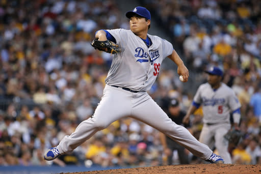Los Angeles Dodgers starting pitcher Hyun-Jin Ryu (99) delivers during the fourth inning of a baseball game against the Pittsburgh Pirates in Pittsburgh Monday, July 21, 2014. (AP Photo/Gene J. Puskar)