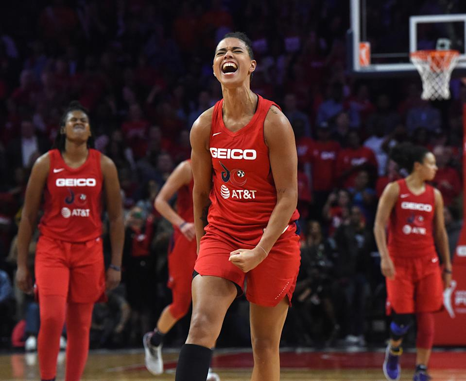 The Washington Mystics' Natasha Cloud celebrates after defeating the Connecticut Sun, 89-78, in Game 5 of the WNBA finals at Entertainment and Sports Arena in Washington, D.C., on Thursday, Oct. 10, 2019. (Brad Horrigan/Hartford Courant/Tribune News Service via Getty Images)