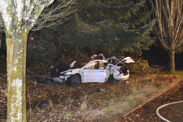 The scene where an Oregon man crashed a Tesla while going about 100 mph, destroying the vehicle, a power pole and starting a fire when some of the hundreds of batteries from the vehicle broke windows and landed in residences in Corvallis, Ore., in November 2020. (Corvallis Police Dept. via AP)