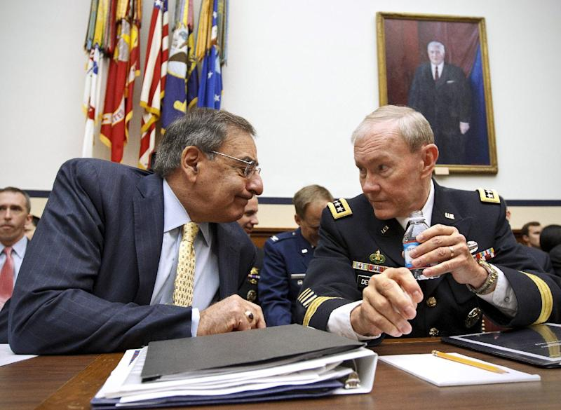 FILE - In this April 19, 2012 file photo, Defense Secretary Leon Panetta and Joint Chiefs Chairman Gen. Martin Dempsey confer on Capitol Hill in Washington prior to testifying. U.S. officials have settled on two main explanations for why Afghan security forces are turning their guns on their Western partners: infiltration by the Taliban and a U.S.-Afghan culture clash. Both causes suggest the problem may persist or worsen as American and other coalition forces shift further into an advisor role.  (AP Photo/J. Scott Applewhite, File)