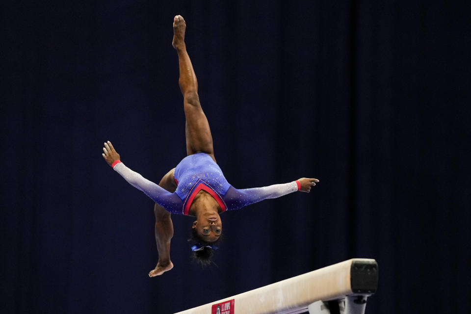 Simone Biles competes on the balance beam during the women's U.S. Olympic Gymnastics Trials Friday, June 25, 2021, in St. Louis. (AP Photo/Jeff Roberson)