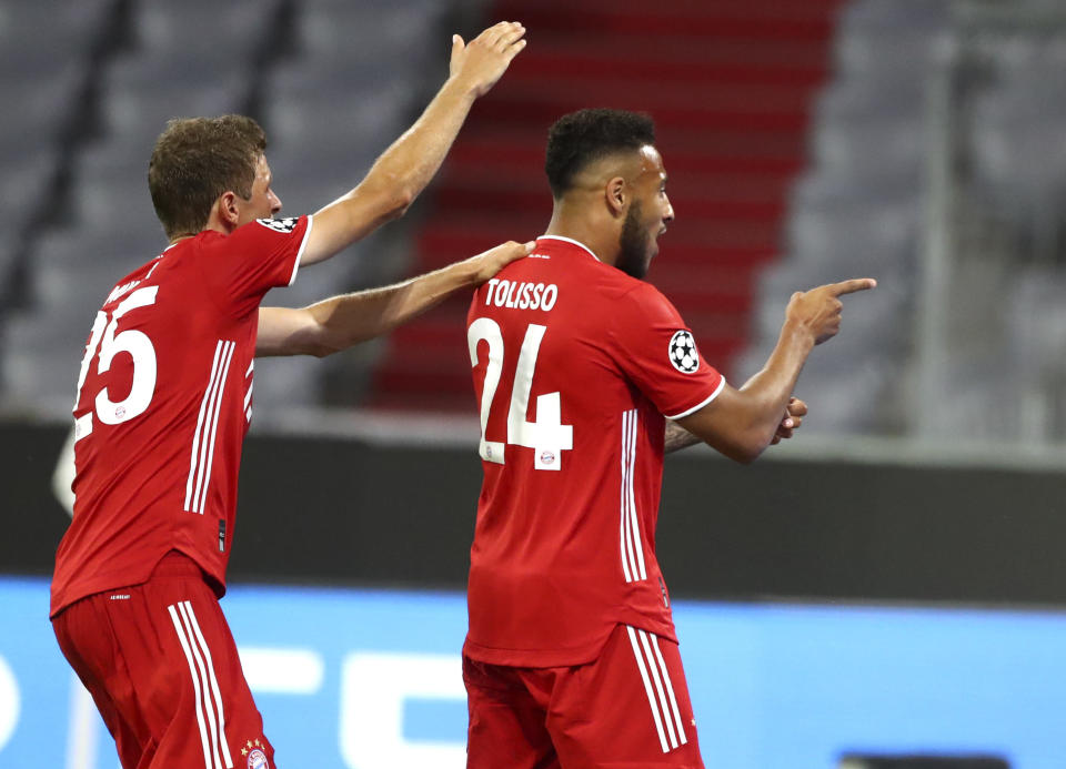 Bayern's Corentin Tolisso, right, celebrates after scoring his team's third goal during the Champions League round of 16 second leg soccer match between Bayern Munich and Chelsea at Allianz Arena in Munich, Germany, Saturday, Aug. 8, 2020. (AP Photo/Matthias Schrader)