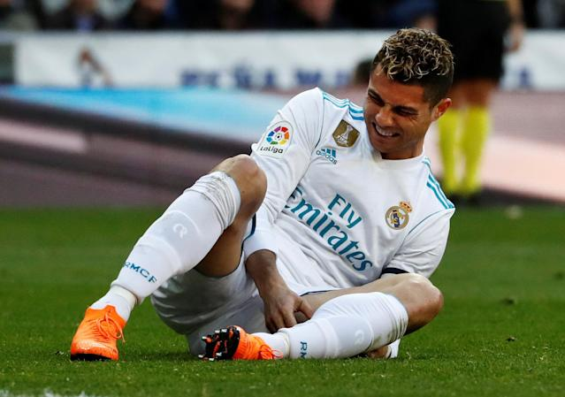 Soccer Football - La Liga Santander - Real Madrid vs Deportivo Alaves - Santiago Bernabeu, Madrid, Spain - February 24, 2018 Real Madrid's Cristiano Ronaldo reacts after a challenge REUTERS/Juan Medina