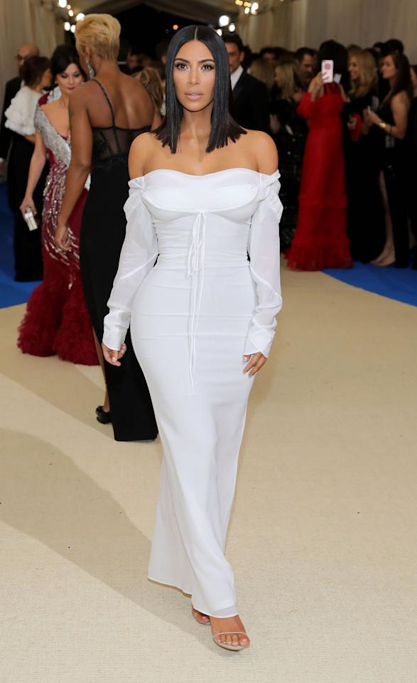 <p>Kim Kardashian West wore an off-the-shoulder white dress by designer Vivienne Westwood. The reality star noticeably wasn't wearing any jewelry. (Photo by Neilson Barnard/Getty Images) </p>