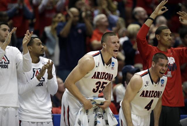 The Arizona bench cheers during the first half in a regional final NCAA college basketball tournament gameagainst Wisconsin, Saturday, March 29, 2014, in Anaheim, Calif. (AP Photo/Jae C. Hong)