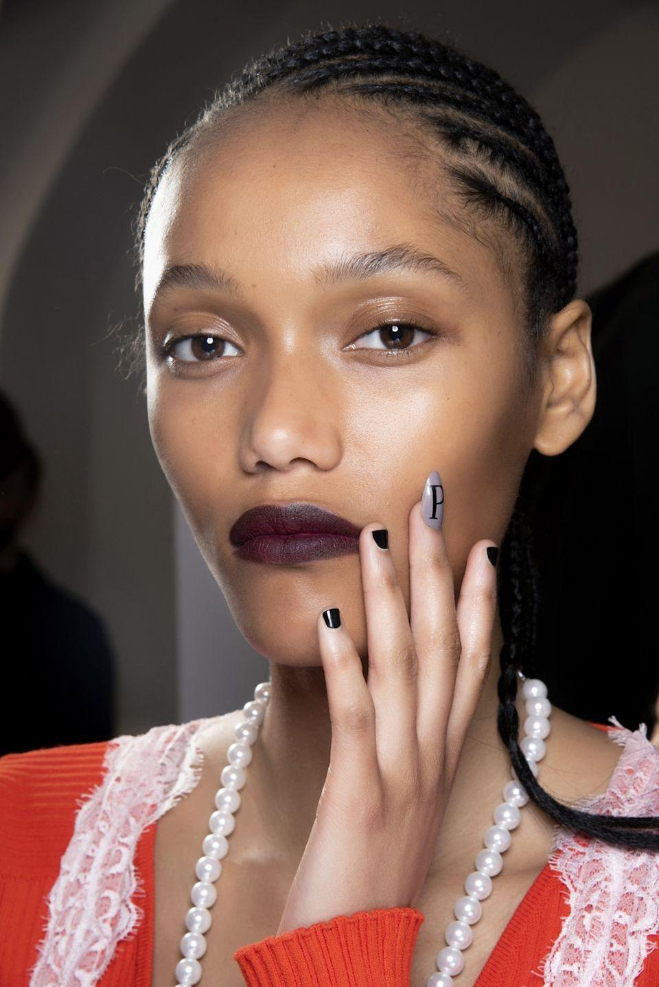 """<p>At Pucci, nails were accented with a single """"p"""" that was a more minimalist take on the always-cool logo nail trend. </p>"""