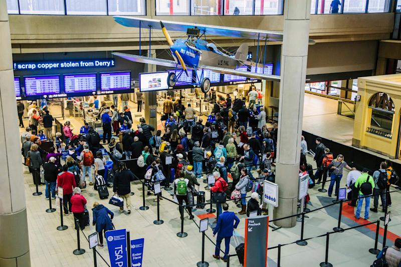 Travelers wait in security lines at the Pittsburgh International Airport on Tuesday, Nov. 20, 2018, in Moon, Pa. Thanksgiving travelers got help from favorable weather in most of the U.S. on Tuesday, but forecasters say a major winter storm across the northern tier could play havoc with travelers heading home during the weekend.'s end.