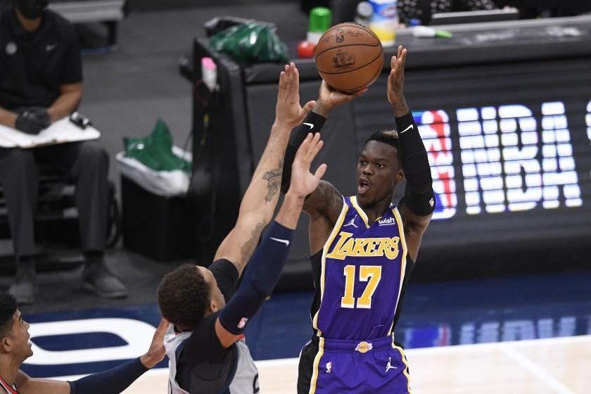 Los Angeles Lakers guard Dennis Schroder (17) shoots during the second half of an NBA basketball game.
