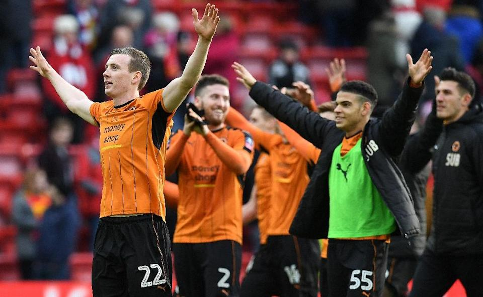 Wolverhampton Wanderers' Icelandic striker Jon Dadi Bovarsson (L) celebrates with teammates following the English FA Cup fourth round football match between Liverpool and Wolverhampton Wanderers on January 28, 2017 (AFP Photo/Paul ELLIS)