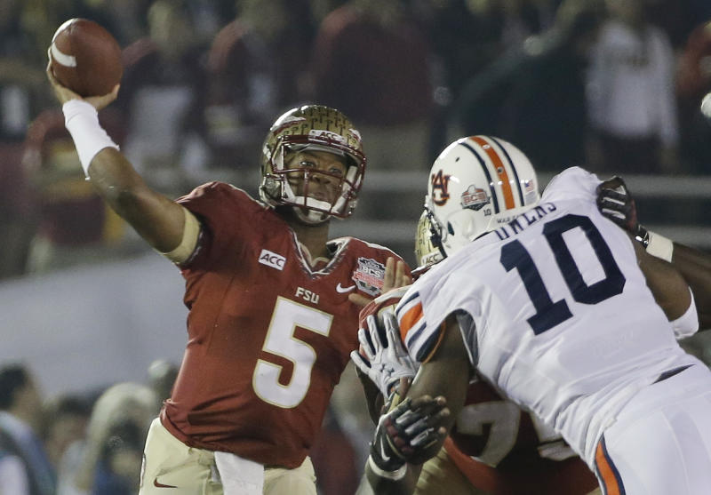 Florida State's Jameis Winston (5) throws during the first half of the NCAA BCS National Championship college football game against Auburn Monday, Jan. 6, 2014, in Pasadena, Calif. (AP Photo/David J. Phillip)