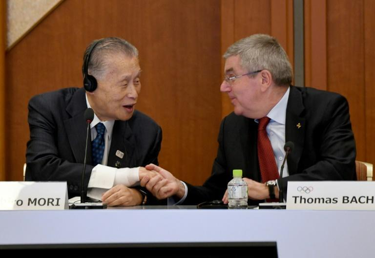 Tokyo 2020 president Yoshiro Mori (left) said the city should not 'relax' despite preparations being on track