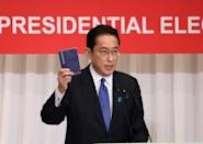 Former LDP policy chief Fumio Kishida carries around a notebook with suggestions from the public (AFP/YOSHIKAZU TSUNO)