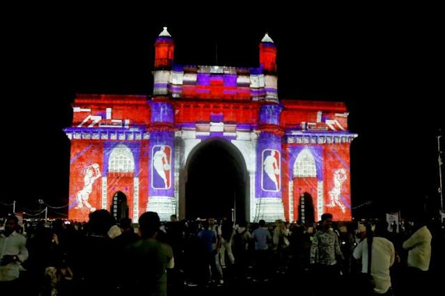 One of the biggest changes mooted would see the final four teams in the playoffs reseeded on the basis of their regular season records, rather than by conference; the Gateway of India monument is lit up with graphics and the logo of the NBA ahead of first preseason games in India (AFP Photo/Bhushan Koyande)