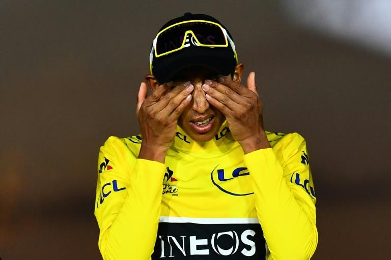 Colombia's Egan Bernal on the Tour de France podium last July in his Ineos yellow jersey (AFP Photo/Marco Bertorello)