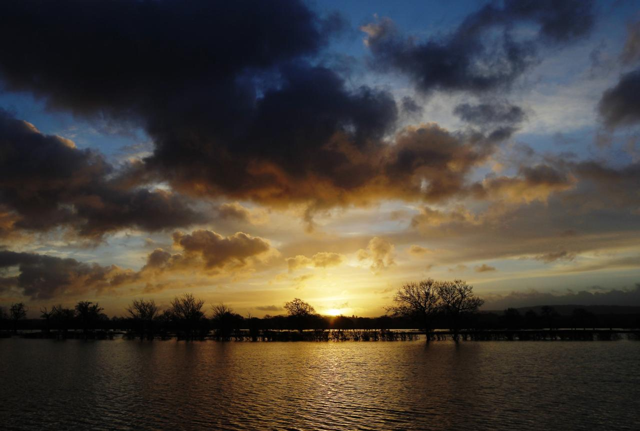 The sun rises over flooded fields at Pulborough